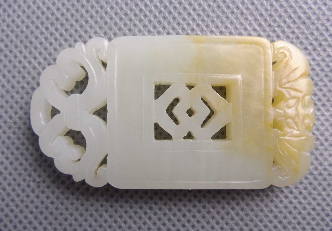 An White Jade Handpiece Carved in Bat and Coin Sign