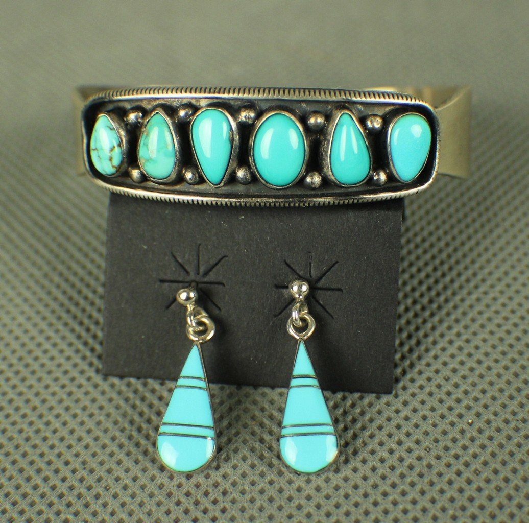 A Turquoise Silver Bracelet and Earrings by Famouse