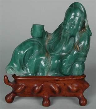 GREEN QUARTZ OR JADE FIGURE OF A MAN