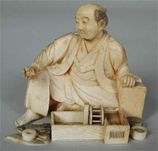 19TH C. JAPANESE IVORY MAN WITH CAGE & RAT