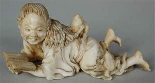19TH C. JAPANESE FIGURE OF CHILD READING W/