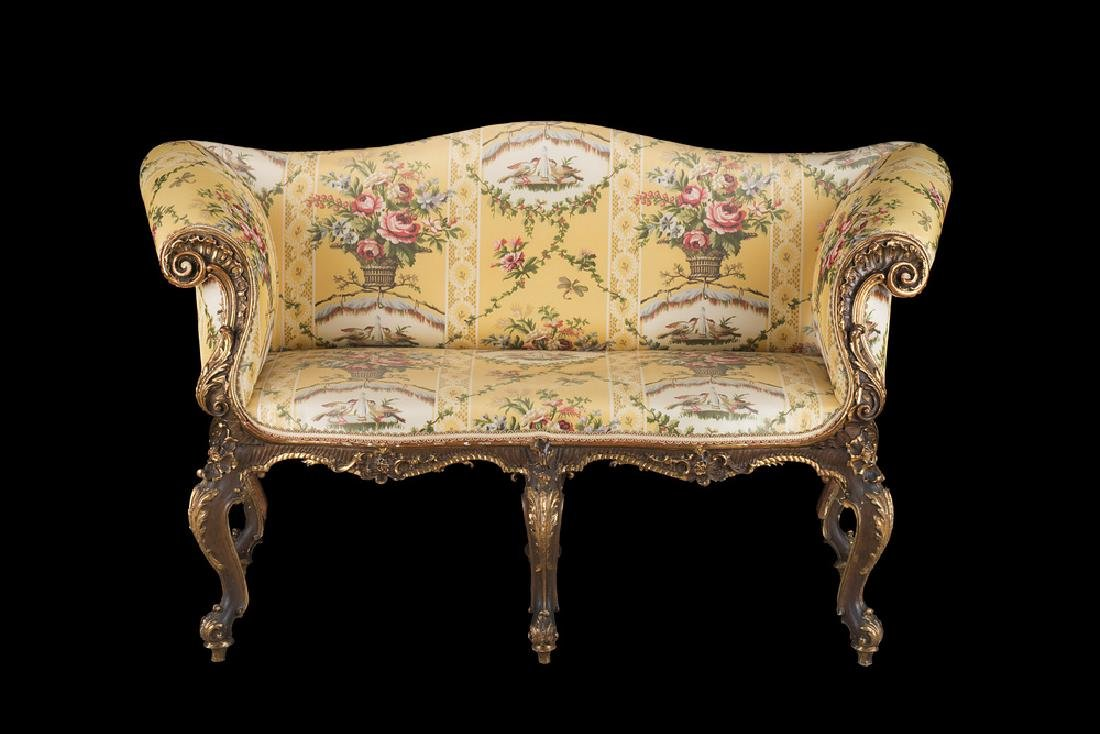 A 19th-century lacquered and giltwood sofa