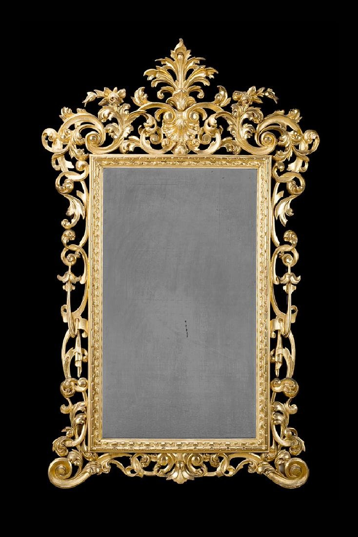 A 19th-century giltwood mirror (cm 160x93) (defects and