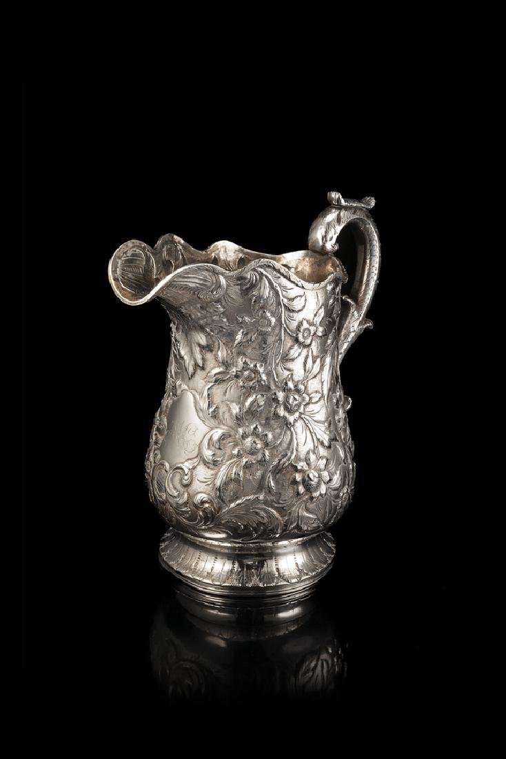 Baltimore coin silver jug with repuossè floral