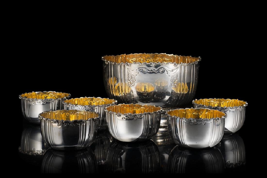 A silver fruit salad service comprising a large bowl