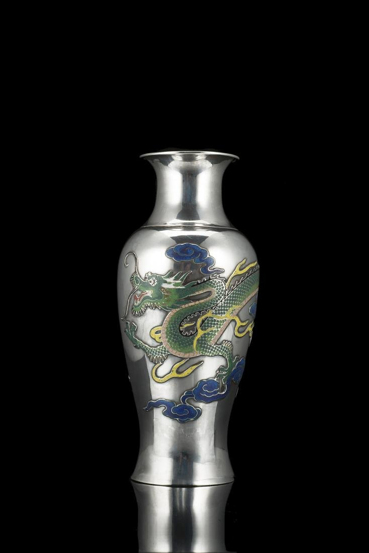 A silver baluster vase decorated with a dragon, with