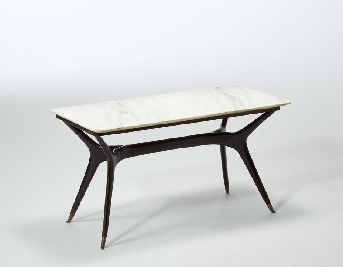 A rectangular coffee table with a Carrara marble top
