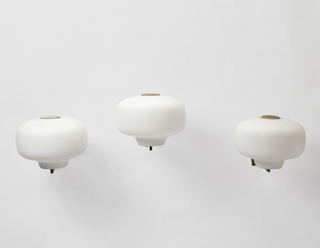 Stilnovo  Three wall lights with brass and white metal