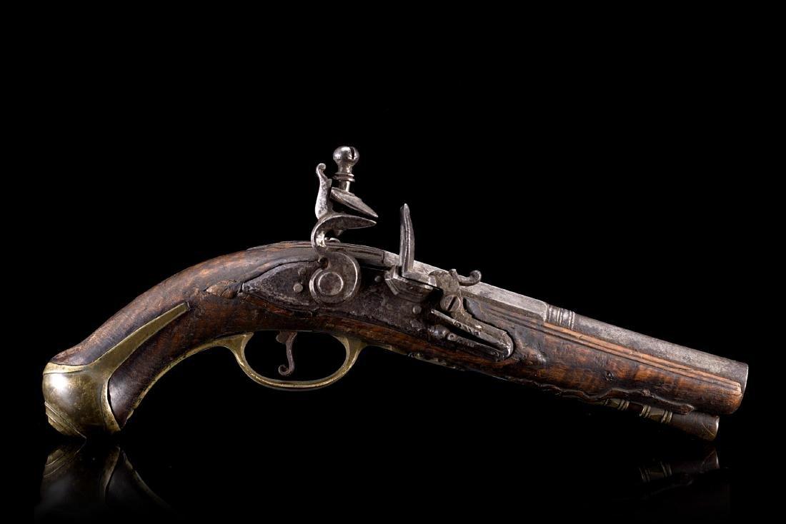 Piccola pistola a pietra focaia da viaggio, Italia,