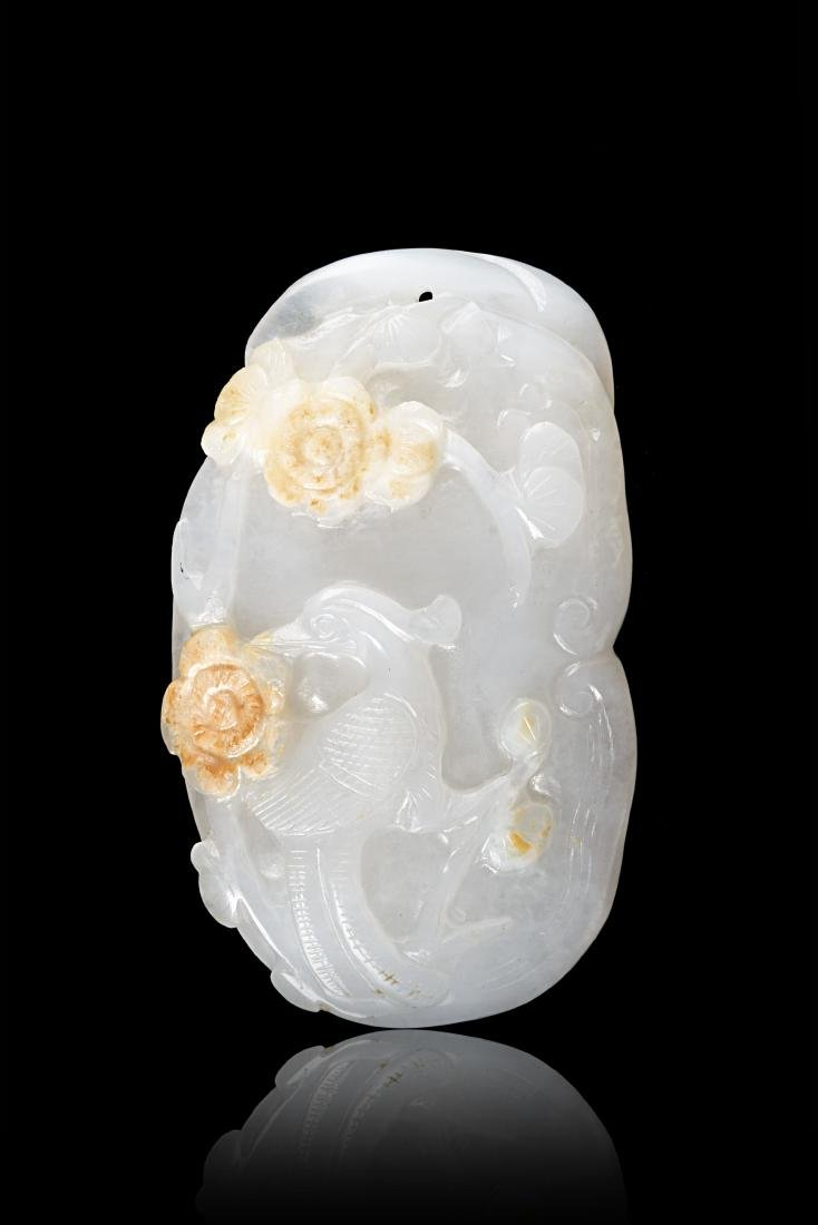 A white jade carving of a long-tailed phoenix with