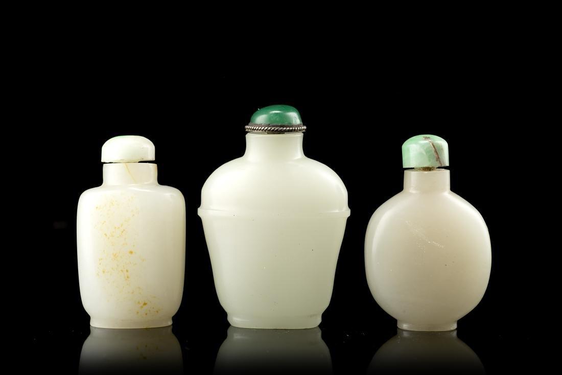 Three celadon jade snuff bottlesChina, 20th century(h.