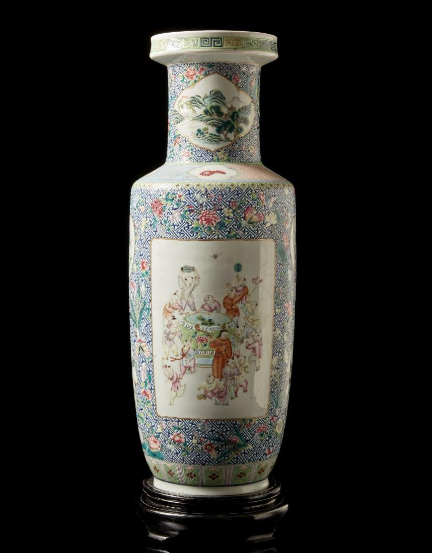 A Famille Rose rouleau vase decorated with panels