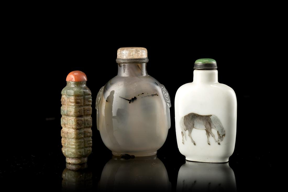 Three snuff bottles: the first made of porcelain with