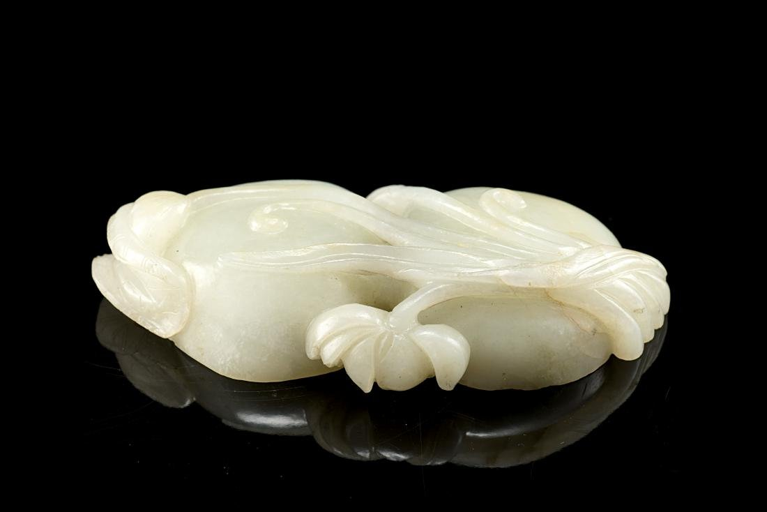 A pale celadon jade carving naturalistically modelled