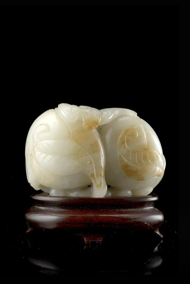 A celadon jade group depicting a 'bat and fruiting