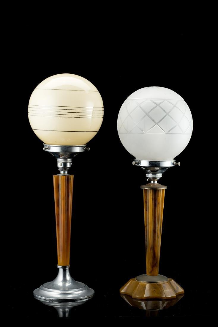 Two Art déco table lamps. 20th century. (h 41 cm.; h 44