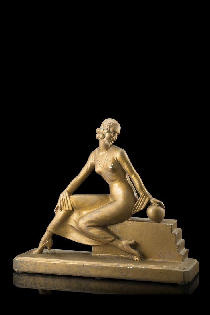 Seated woman art déco sculpture. 20th century. Signed
