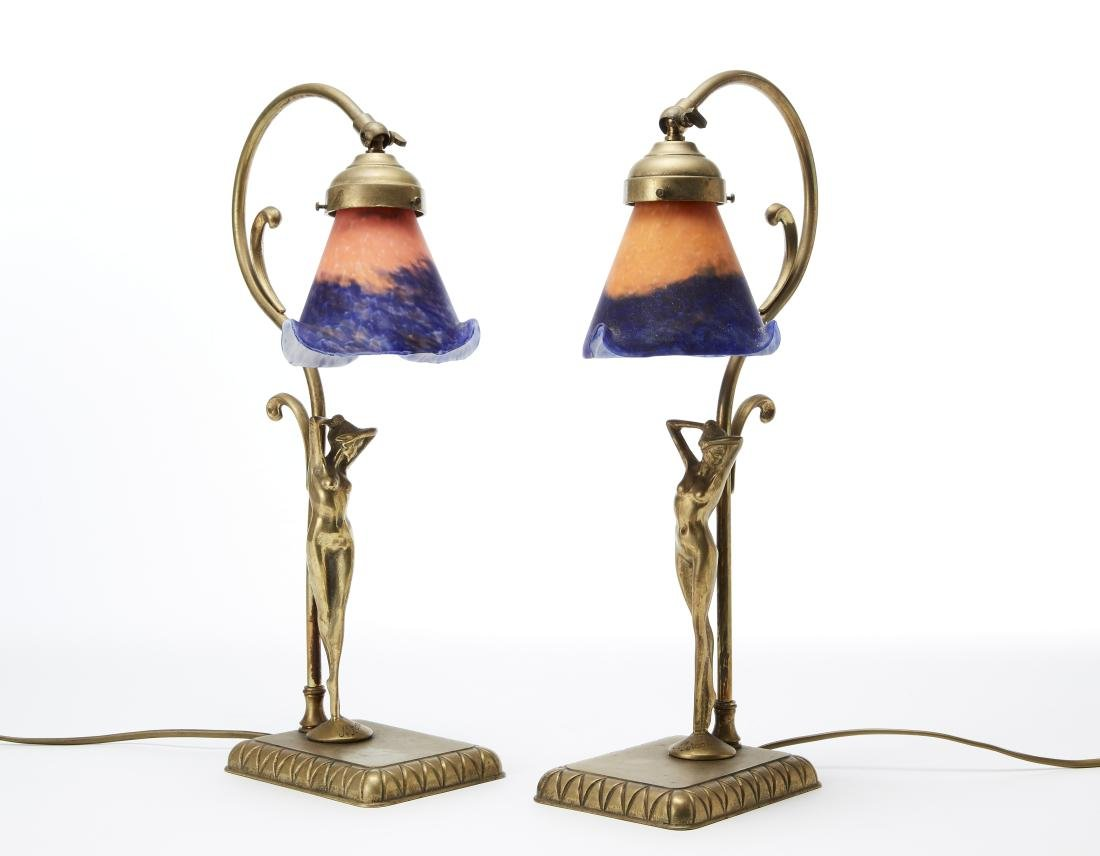 Two Art déco table lamps decorated with female