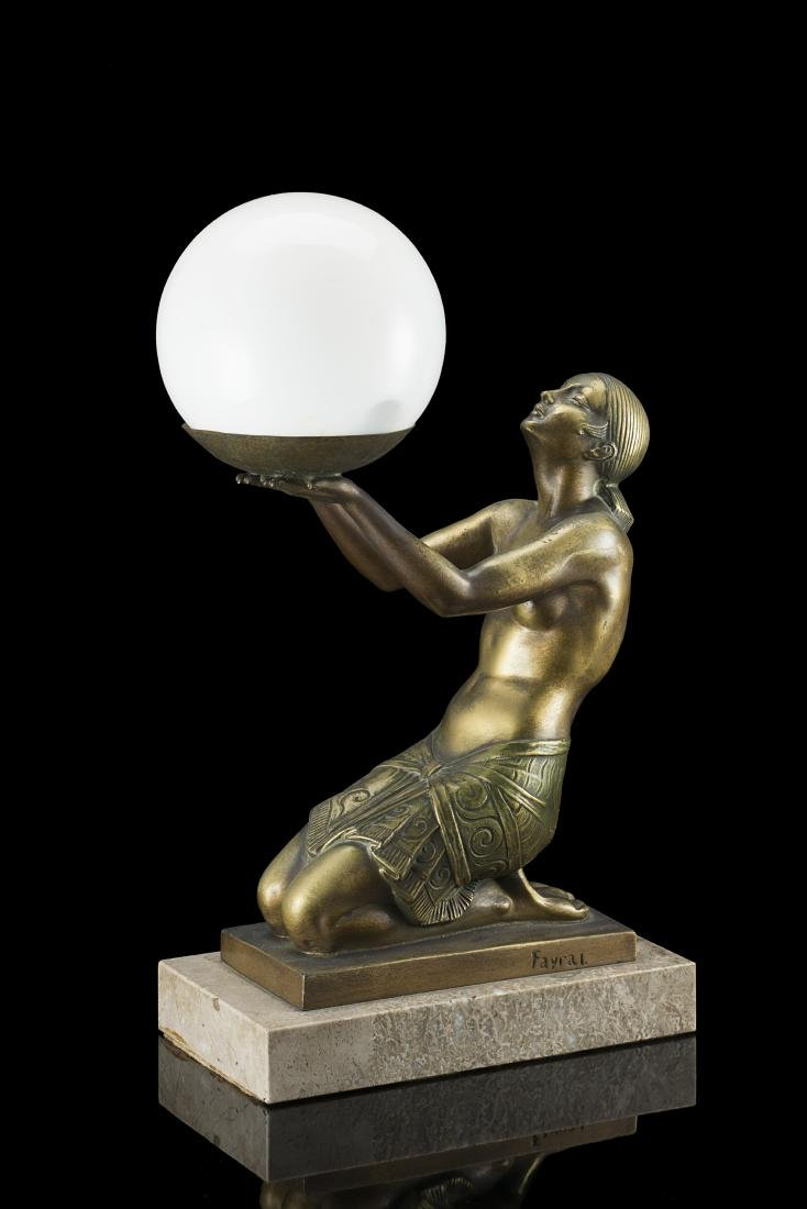 Fayral Table lamp decorated with female sculpture.