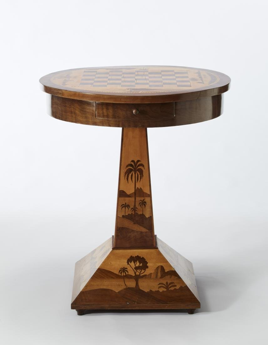 Round coffee table with veneered top small drawer.