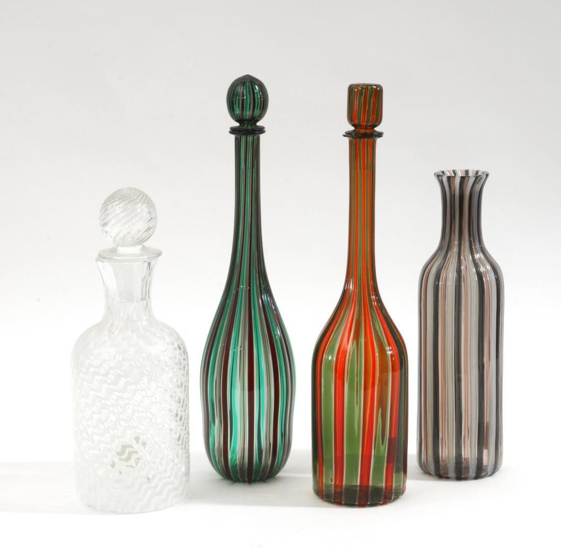 Manifattura di Murano Gruppo di quattro bottiglie in