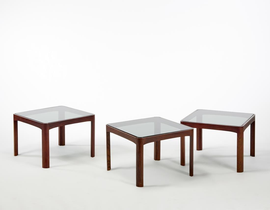 Tre tavolini in legno massello di palissandro indiano,