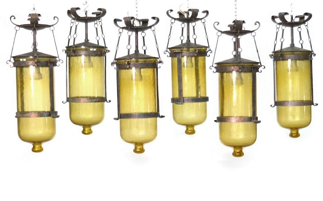Sei lampade a cesendello con struttura in ferro battuto