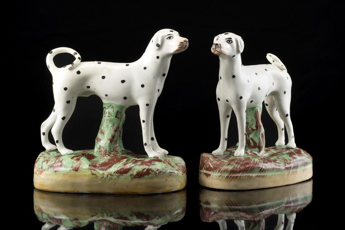 A pair of polychrome ceramic Dalmatians. English