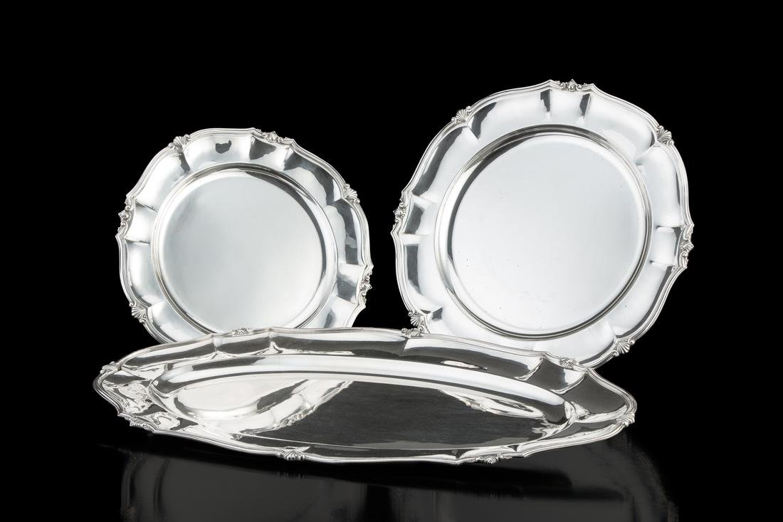 Two silver plates and an oval silver tray. Italy,
