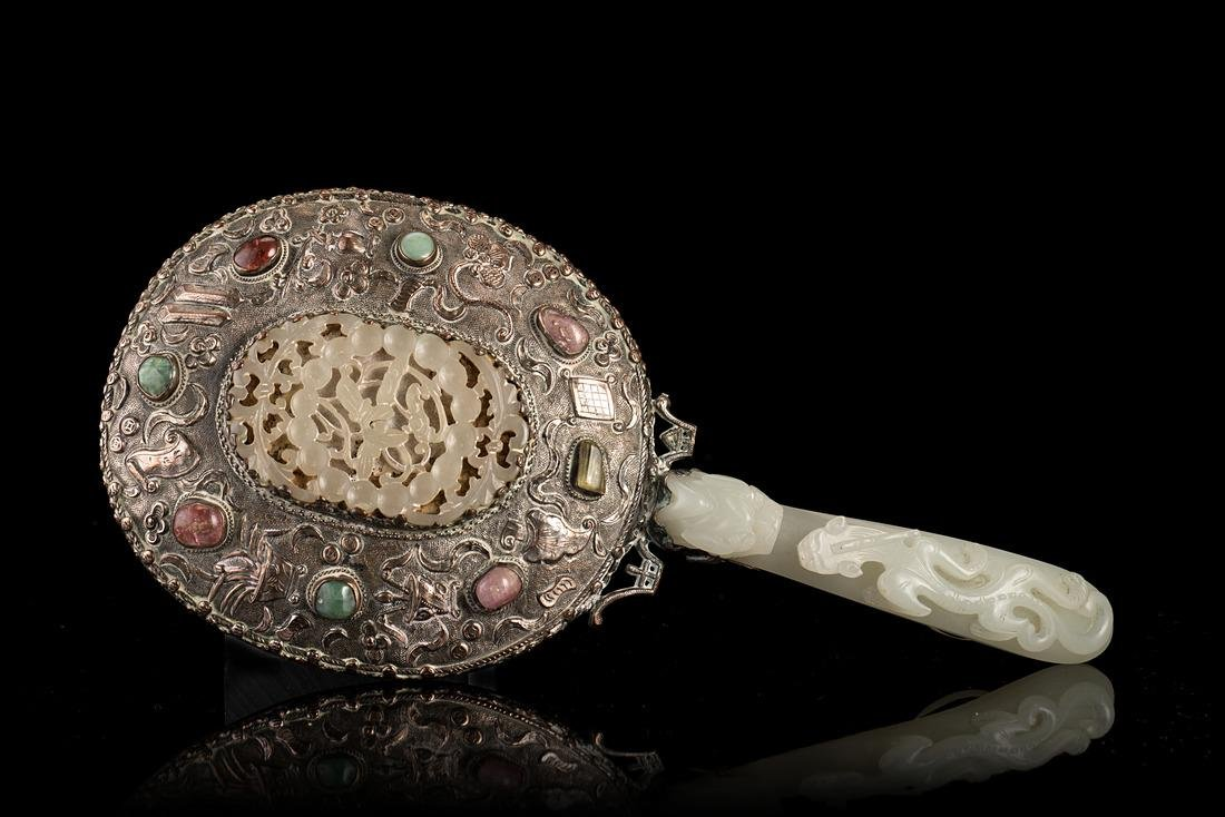 A silver mirror with insert hardstones and jade plaque,