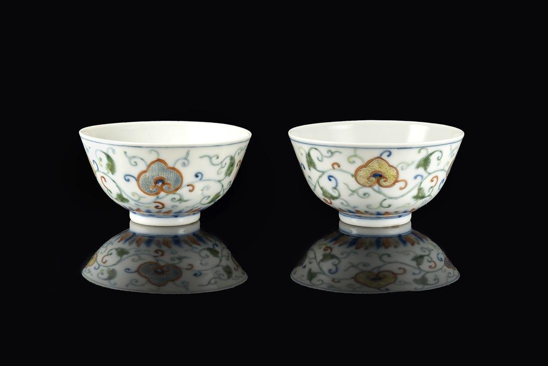 A pair of small doucai cups decorated with floral