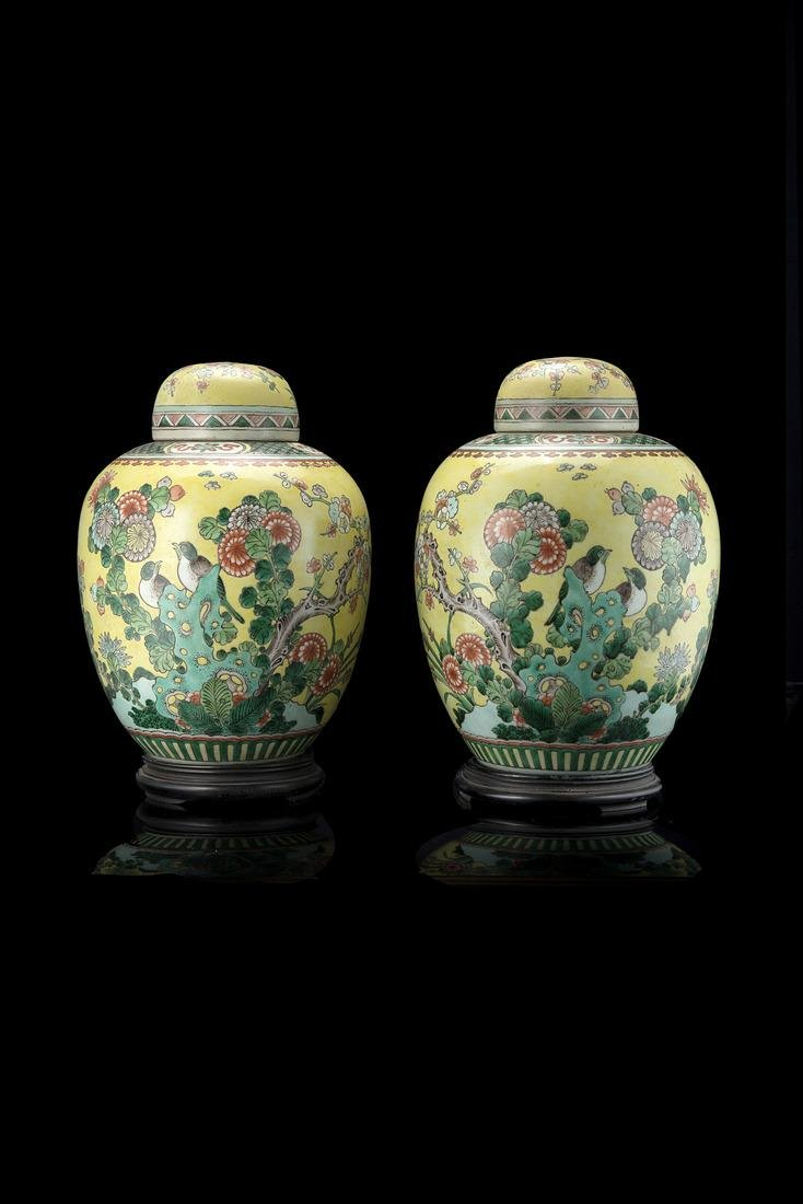 A pair of yellow ground Famille Verte potiche and