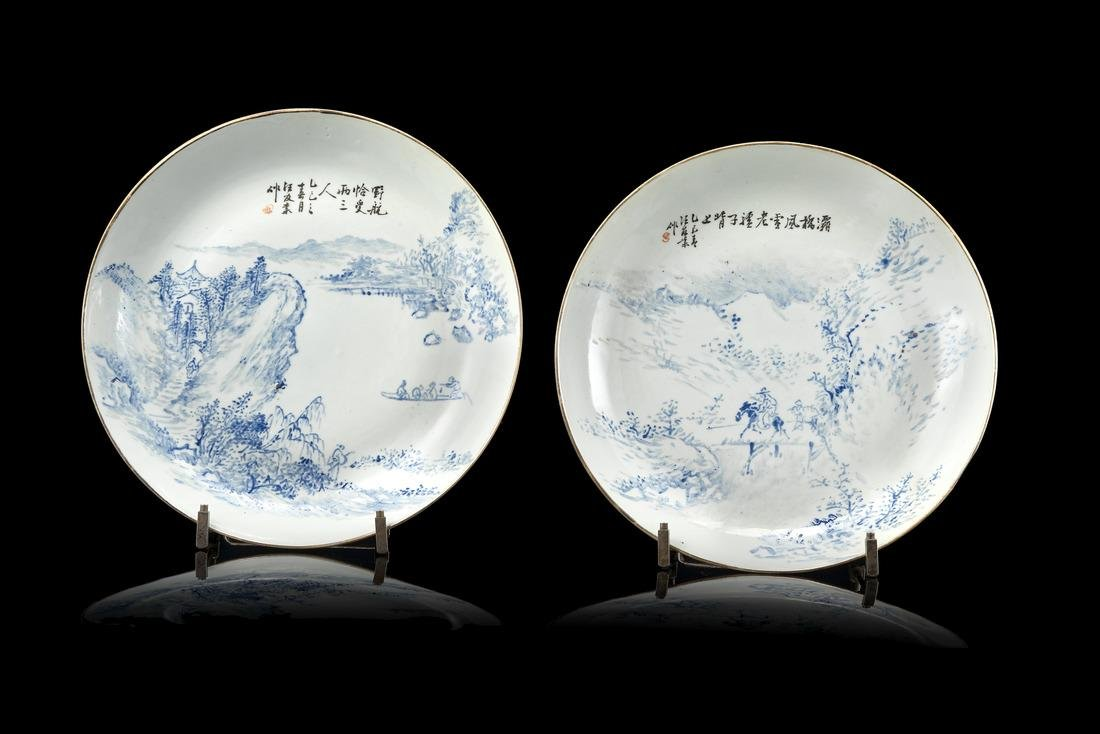 A pair of blue and white dishes decorated with