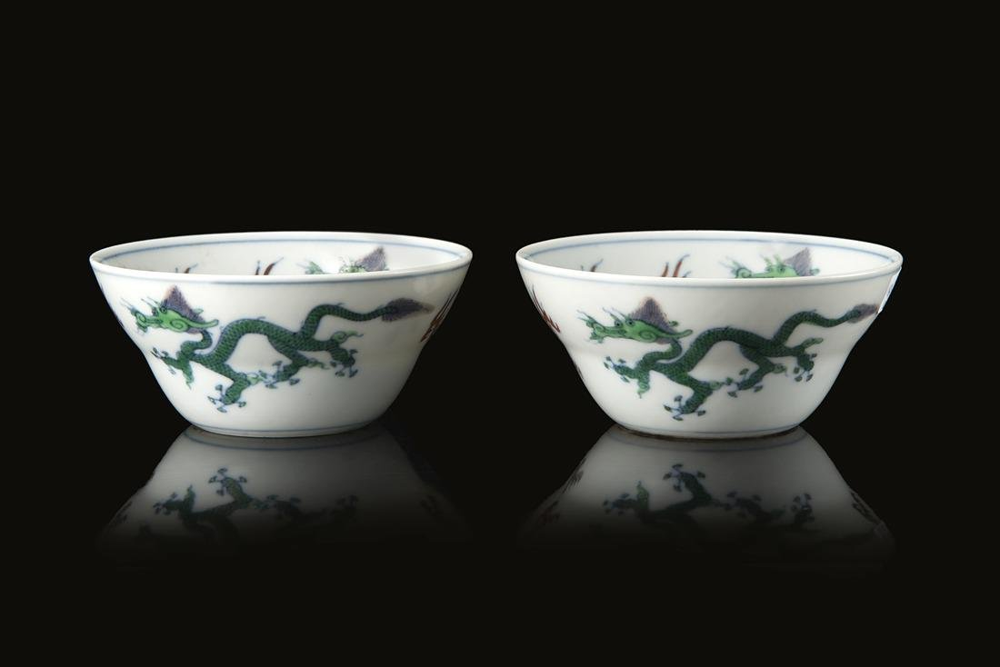 A pair of doucai porcelain cups decorated with pairs of