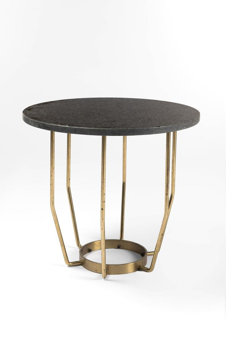 Coffee table with circular gray granite top and
