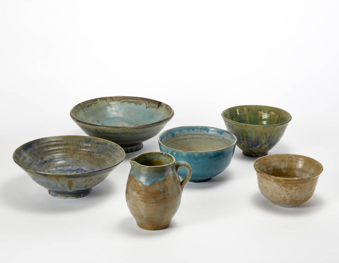 Group of five bowls and a glazed ceramic pitcher with