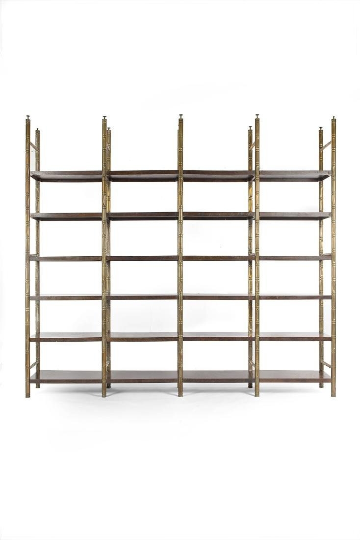 Bookcase with uprights in polished brass simulating