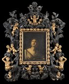 A Baroque lacquered giltwood frame (cm 160x137)