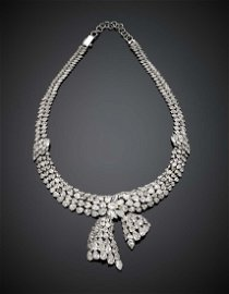 Pear and marquise diamond white gold knotted ribbon