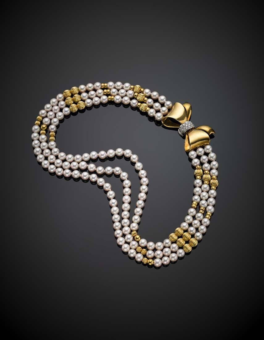 Three strand pearl necklace with yellow gold spacers
