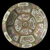 A large Cantonese Famille Rose basin enamelled and gilt