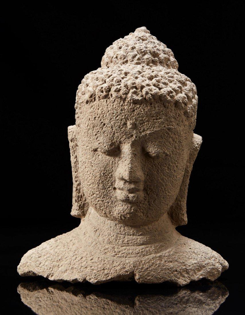 A grey stone buddha head