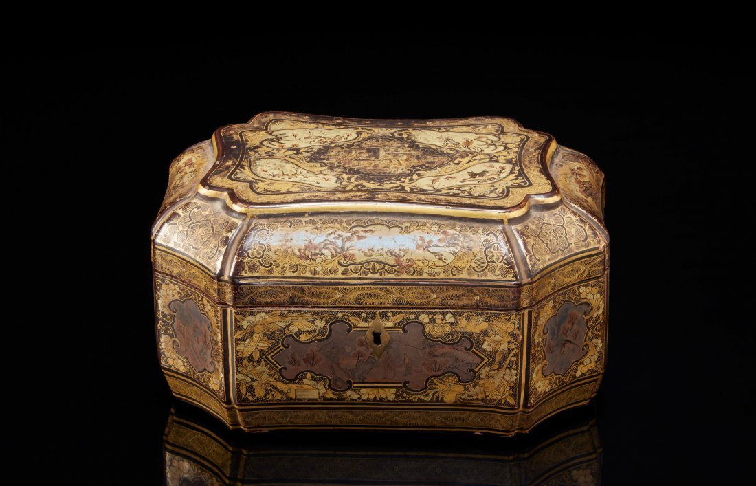 An octagonal tea box lacquered in black and gilt