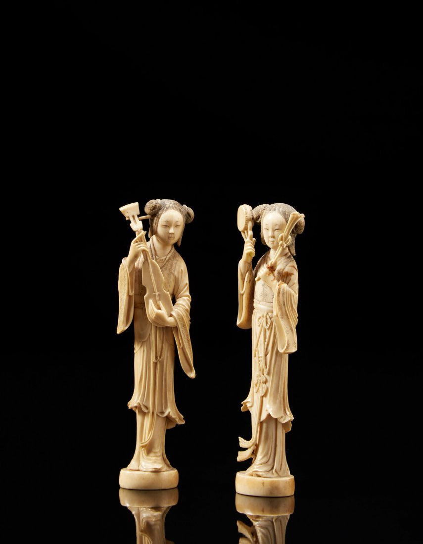 Two ivory carvings of ladies carrying musical