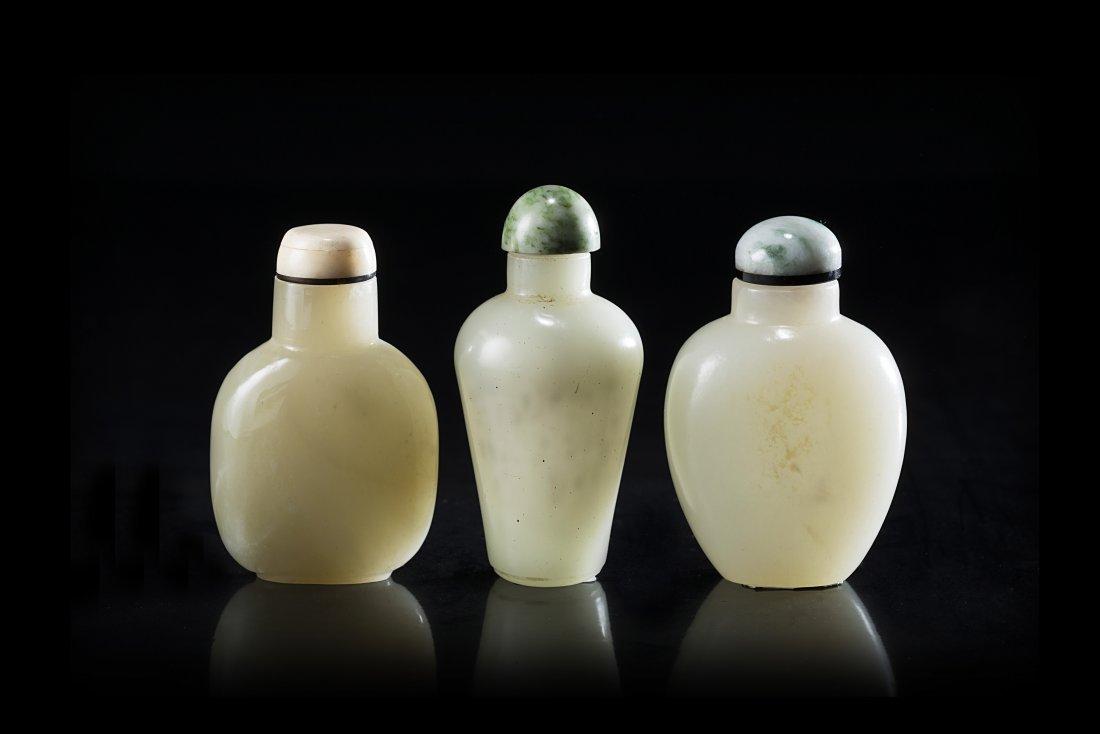 Three celadon jade snuff bottles of various forms