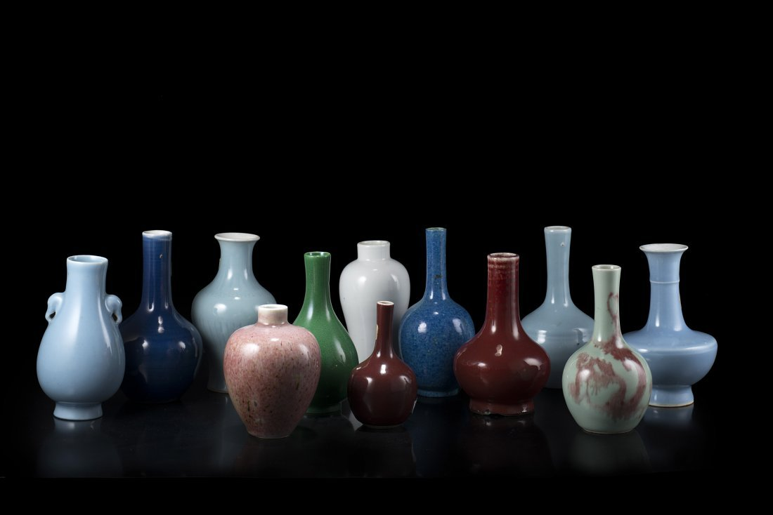 A group of 12 small vases of various form