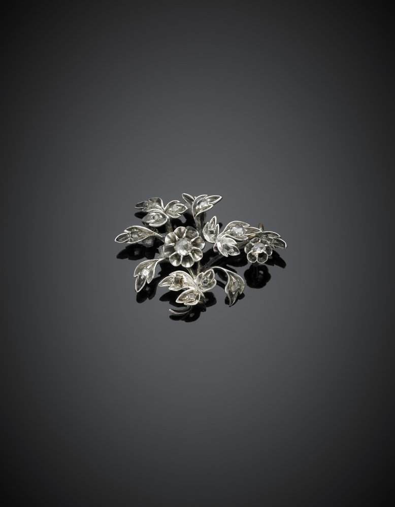 Silver brooch with irregular diamonds and golden pin,