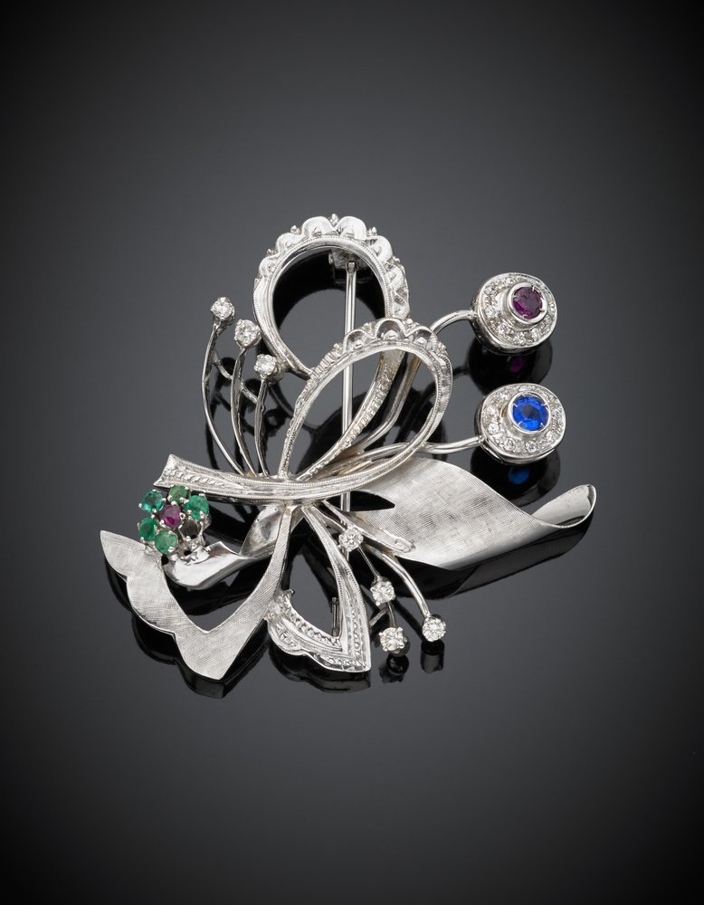 A diamond, ruby, emerald and sapphire white gold brooch