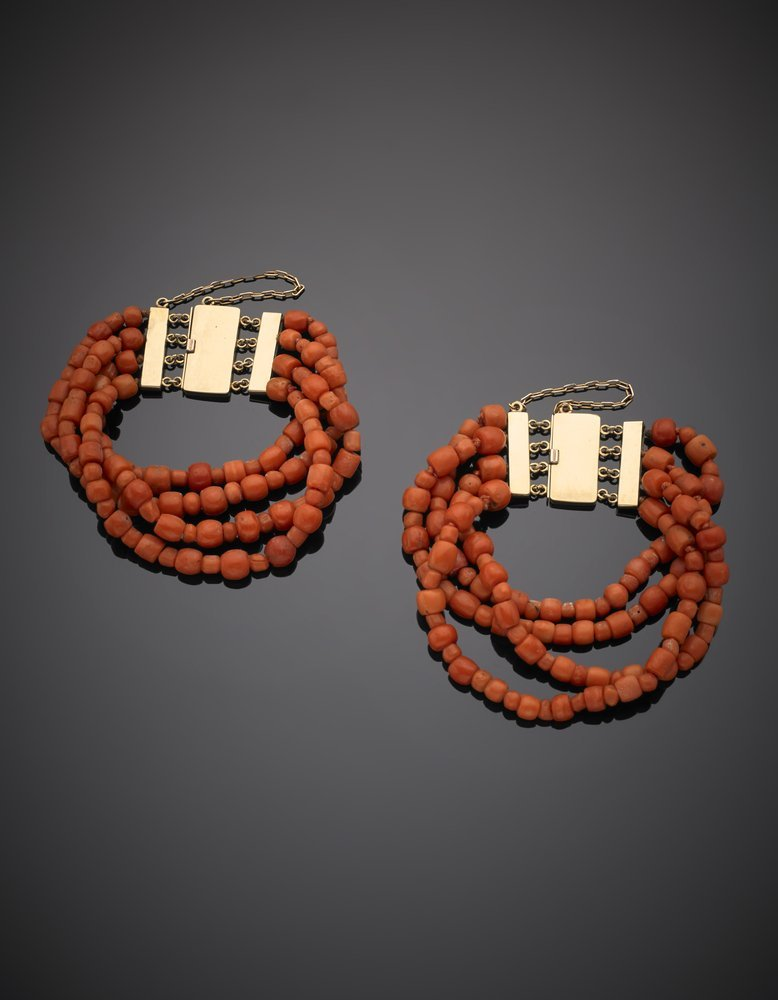 Two four-strand orange coral bead bracelets with gold