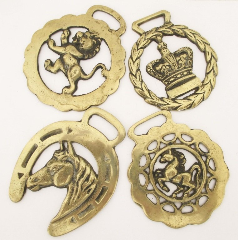 FOUR EARLY 20TH CENTURY HORSE BRASSES